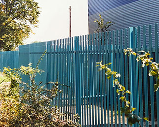Factory unit boundary palisade fence in corporate colour