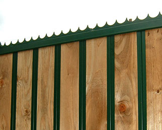 Unison timber fence reinforced with steel sections